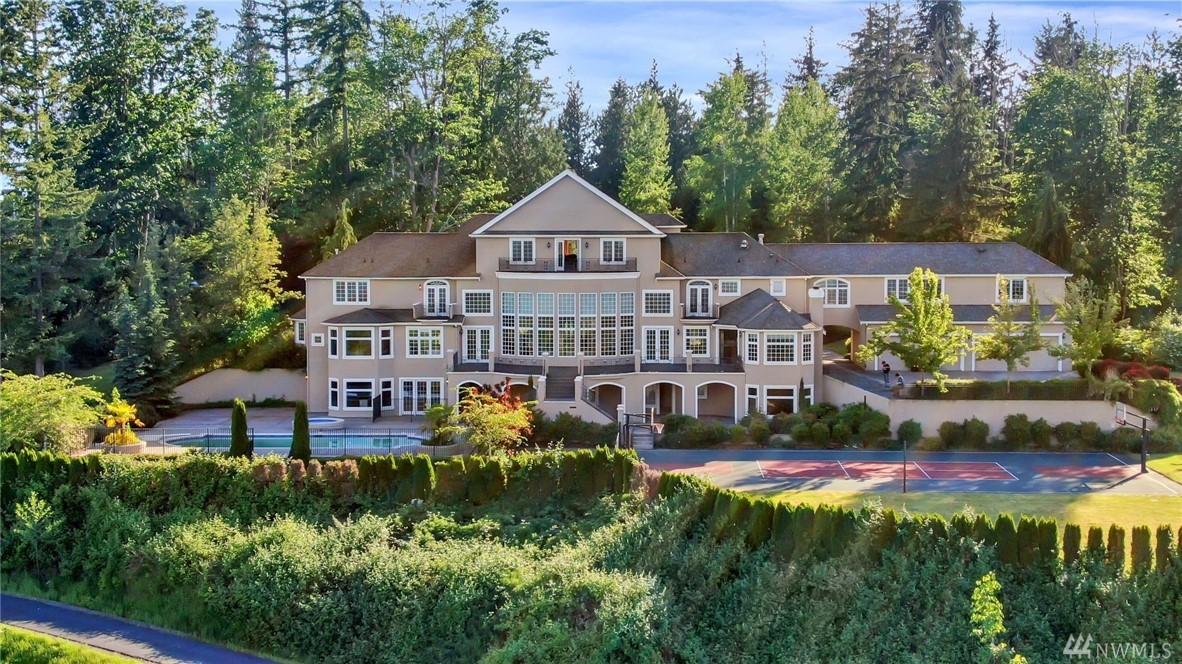Breathtaking, elegant & luxurious. This magnificent 13,540 sqft custom home has all the features you dream of. Sitting on top of Union Hill, overlooking the spectacular views of the Cascade Mts. and Carnation Valley. Gated with over 7 private acres, dual grand staircases, huge windows, 2 chef's kitchens, 3 offices, 4 car garage, elevator, theater, exercise & dance studio, wine cellar, sauna, meeting rooms, pool with hot tub, sports court and MIL wing. Buyer to verify all the info.