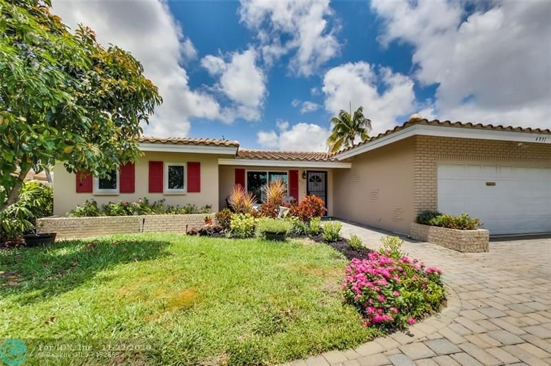 Stop now and look no further! Large 2 bedroom master split floor plan. Great layout for entertaining!  Separate laundry room, large pantry, 2 car garage with circular driveway. Rare find on a great street in an awesome neighborhood. Enjoy the pool in a beautifully landscaped  backyard with low maintenance artificial turf. New roof (2018) impact windows (2017) pool motor (2019) pool heater/cooler (2017). All the heavy lifting is done!  Come make this your home.