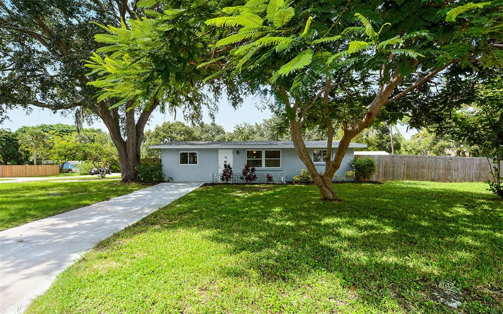 """""""WEST OF THE TRAIL"""" single family block constructed home on a large corner lot with close proximity to beaches and shopping!  This beautifully updated home features a kitchen w/granite countertops, Samsung SS Appliances, hot water heater.. The master bath has dual sinks and a walk-in shower. This home has been re-plumbed and has newer windows throughout. There is plenty of storage with the 20x10 storage shed and lots of room to add a pool!   Close to several shopping plaza's, restaurants and more. Benderson Development has plans to build """"Siesta Promenade"""" which anticipates condominium & apartment units, a hotel and up to 140k of retail space with high end shopping and restaurants, all this will be walking distance from this home but far enough away to enjoy your tranquil slice of paradise.  This home would make the perfect home,  2nd(vacation) home or rental investment property!  This home is close enough to bike ride or walk to the beaches."""