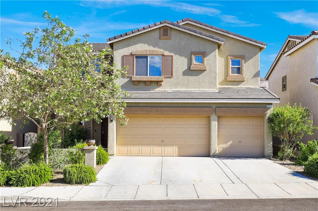 Beautiful two-story w/4BDRs, 3BTHs & 3-car garage in Henderson! Home features 1BDR down and BTH down is equipped w/walk-in shower. Wonderful great room layout w/living area, dining area & kitchen in one space. Home features upgraded lovely wood-look tile flooring running seamlessly t/o the main level & dry bar in the living area. Gorgeous kitchen is elevated w/ss appliances, vent hood, island & breakfast bar combo w/2 pendant lights, granite counters, stylish backsplash, 5-burner gas cooktop, microwave, recessed lighting & walk-in pantry. All BDRs have walk-in closets & plush carpet. Grand double door entry into generous primary suite enhanced w/ceiling fan & relaxing private balcony. Primary BTH boasts dual sink vanity, upgraded fixtures, water closet, garden tub & walk-in shower. A Jack & Jill bathroom w/dual sinks is present for secondary BDRs & laundry room has built-in cabinets. Enjoy the lush grass lawn, mature landscape, raised planter beds & covered patio in the backyard.