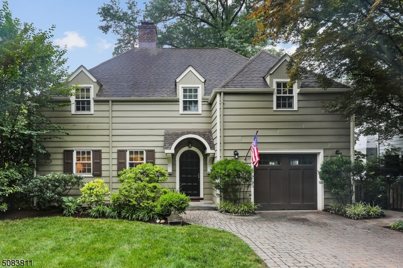 Absolutely charming WYCHWOOD colonial situated on a quiet cul-de-sac. Beautifully renovated 5 BR boasts California Closets in each bedroom.  Closets line the entrance to the primary bedroom suite and steam shower in primary bath will not disappoint. Enjoy the flow of the first floor - living room (wood burning fireplace), dining room, two half baths, laundry/mudroom, EIK and window-lined family room.  Exit the set of french floors either off dining room or kitchen onto the deck under a beautiful, manicured, ivy-topped pergola overlooking beautiful backyard. Side patio, off kitchen, offers another seating option with plenty of room for lounging and dining. The basement has both a rec room, with surround sound stereo system, and private office space. This is the entertainer's dream home you've been waiting for!