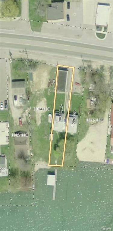 Lakefront Opportunity! Commercial property in front and residential in the back. Real Estate Only sale, business no longer in operation.  Lakefront is zoned R3 and road front is zoned B2. All sales subject to St. Clair County Probate Court approval.