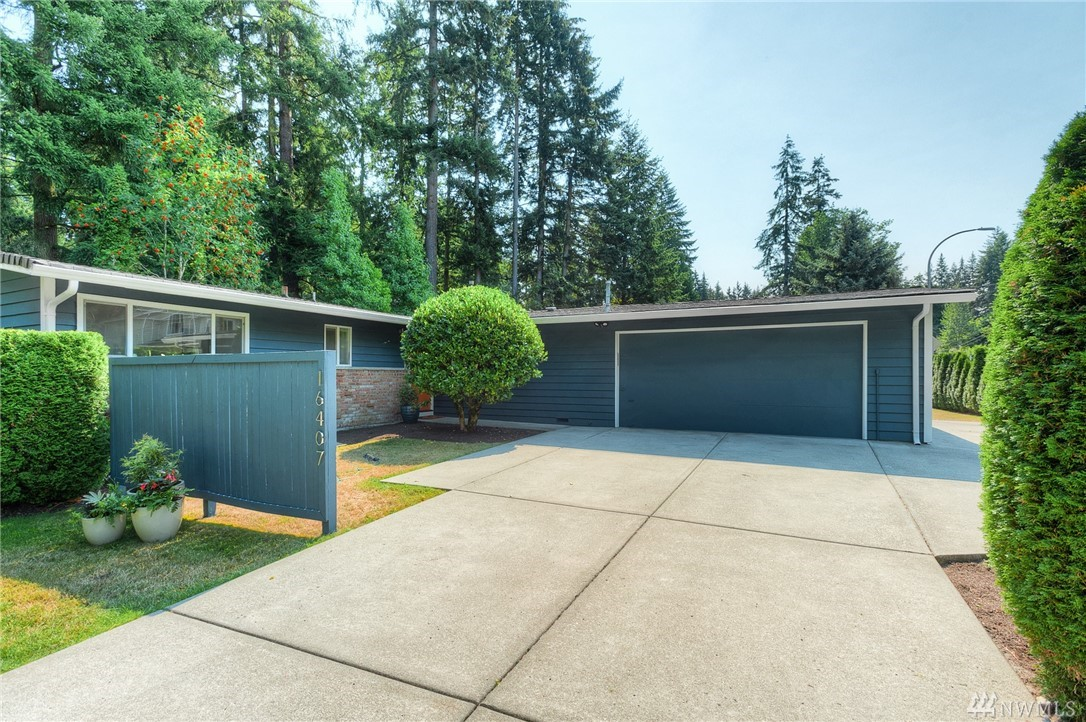 Classy, 1961 Mid-century Modern located in the heart of Sherwood Forest. Just a skip to Microsoft Campus and a breeze to downtown Bellevue and Redmond. Lovingly cared for and updated as well. Fabulous yard with lots of gardening opportunities. New kitchen and baths. Three spacious bedrooms. Vaulted ceilings in formal living and dining rooms; big brick, wood burning fireplace makes for cozy Fall and Winter evenings. Freshly painted inside and out. Fabulous neighborhood and great school district.