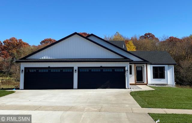 Don't miss this beautiful 4 level walk out home! 3 BR 2 BA finished with custom cabinets, laminate through main floor, HD countertops, corner pantry, and white trim!  Huge 36 x 26 4 stall attached garage plenty of room for your toys! With 2 more levels unfinished for room to grow!