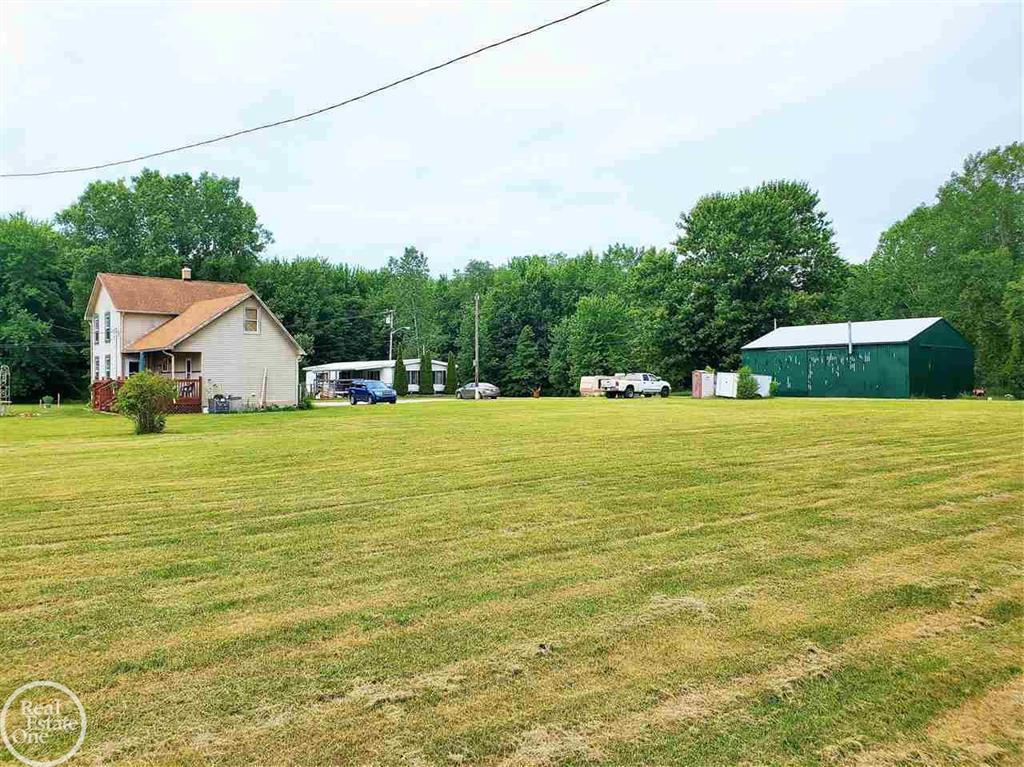 Unique and very interesting 8+ acre parcel w GIGANTIC 200x65 Ft Barn with 20+Ft ceilings, ANOTHER very nice metal barn, 1 farmhouse that is being rented out, and 1 manufactured home that owner lives in. The largest barn in the county, this was used (and still owned by) the owner of the famous Cottrellville Carnival. The barn actually housed ALL the rides, games, semi haulers, and everything that goes with running a full blown Carnival. Ideal for so many purposes! Organic gardening, contractor storage of large heavy equipment, build a dream house, keep for renting and use for storage...the sky is the limit. BY appointment only and advanced notice required.