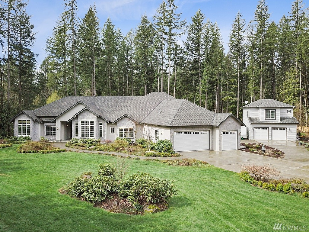 A gorgeous custom home awaits minutes from Downtown Redmond! This 4,450 sq ft rambler boasts open great rm concept,formal dining, formal living rm, 4 lrg bedrms each w/ en suite bth, den & Bonus rm. Custom finishes include travertine floors, oak hardwoods, remodeled chef's kitch, new carpet & gorgeous trim work. Home is situated on private 1.483 Acre lot surrounded by soaring trees+mature landscaping. Lrg 3 car garage+detached 2 car garage w/bonus rm & bth.RV Parking! Walk to Alcott+STEM School!