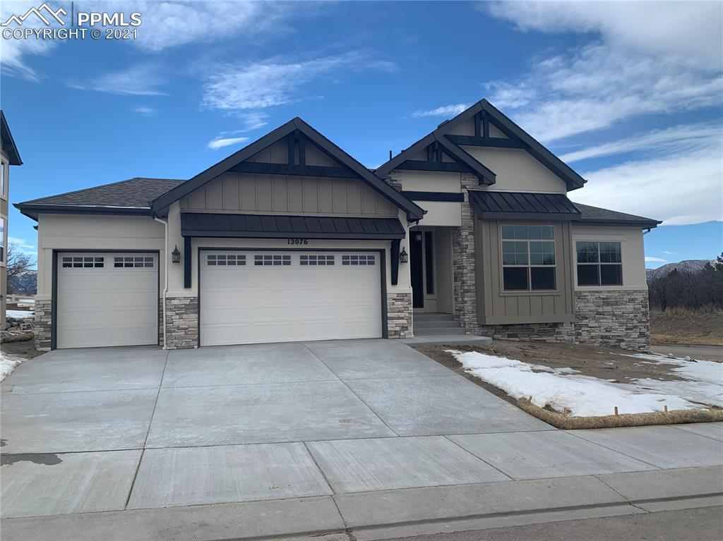 Beautiful open concept with floor to ceiling stone fireplace that will pull you into the heart of the home.  The gourmet kitchen is open and inviting to the great room and will delight the chef of the family.  Enjoy your meals in the huge dining area or take it outside onto the covered deck with composite decking. The master bath has separate vanities, free standing soaker tub and separate shower.   To finish out the main level is an office and guest suite with full bath and walk in closet.  The lower level has 2 oversize