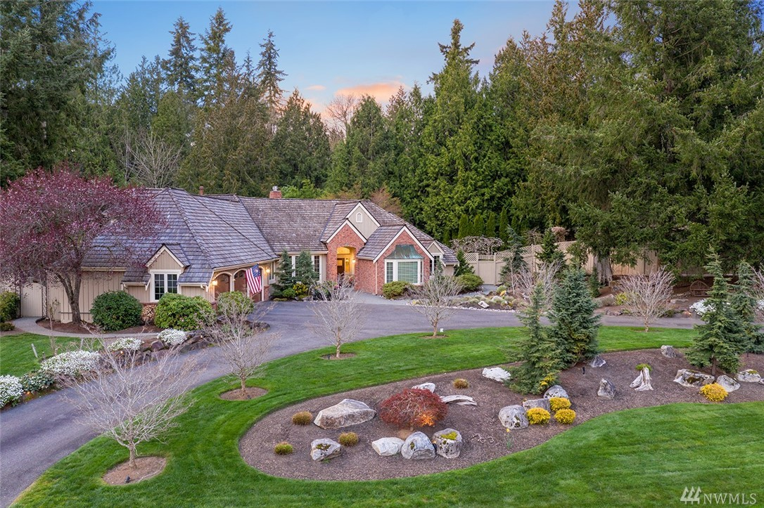 Meander down the streets of Hunters Glen to this vacation-at-home style estate. Substantial Buchan construction with single level/rambler style living and separate upper level area/apartment. Low maintenance indoor lap pool in lodge like recreation area with doors opening up to expansive patio for year around enjoyment.Multiple spaces for entertaining, yet quiet corners for privacy, inside and out.Professionally designed yard includes secret gardens, room for boat/RV. Easy commute access.