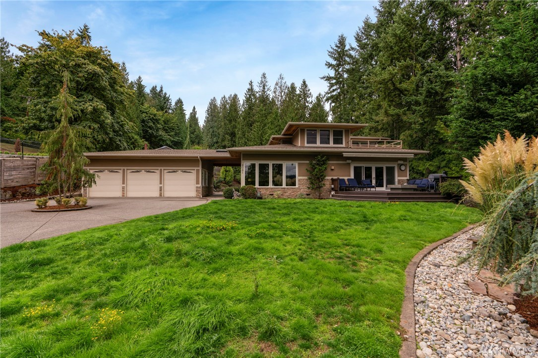Exceptional Frank Lloyd Wright inspired home perched on a secluded 1/2 acre lot overlooking beautiful Lake Sammamish. Fully renovated w/ a simple and elegant contemporary design, this home fits all lifestyles. Interior features include professional chef's kitchen, dual master suites on both levels, loft/office w/ views, & media room w/ wet bar. Four decks compliment views. Private yard is a gardener's dream; lots of room to play! Gated entry. Minutes to I-90.