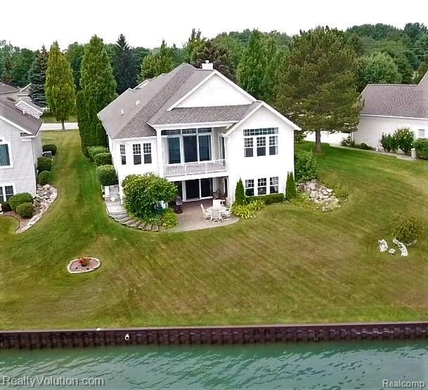 Amazing opportunity to be right on the St. Clair River. Sit and watch the ships go by. Great fishing right out your back door.  Amazing views from most every room. Lots of upgrades done by owner when originally built such as extensive transom windows to really take in the views and an awesome bay window bump out in eat in kitchen which gives 180 degrees of water view. You can literally see for miles each direction down the river. Large kitchen with corian counters, 1st floor laundry. Covered back deck. Open high ceilings. Two bedrooms and two full baths on first floor. Finished lower level offers 3rd bedroom, home office(could be 4th bed), game/tv/reading nook, and expansive great room w/ wet bar. These water front units don't come available often and this is priced to sell quick. Home has new auto generator to operate entire home. Such a great home and location....call soon.