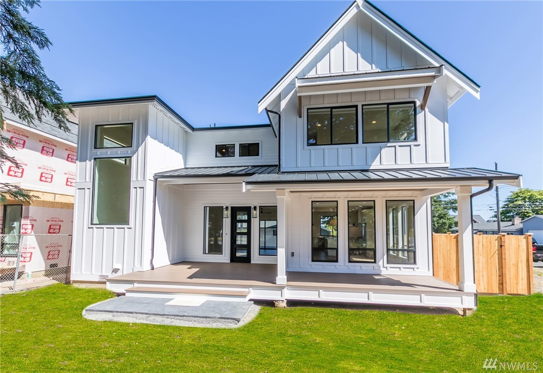New modern farmhouse in the North End! Enjoy living walking distance to Point Ruston, Point Defiance & Baltimore Park. This 2681 SF home features heavy-duty iron front & back doors, LVP hardwoods, custom American-made cabinets, LED lighting, 9ft ceilings on main & upper, heat pump, gas furnace & stove-top. Upstairs offers master & jr master suite + 2 other bedrooms & 3 baths. Covered front & back patios include 793 SF of composite decking. Detached 528 SF garage w/glass door, alley access.