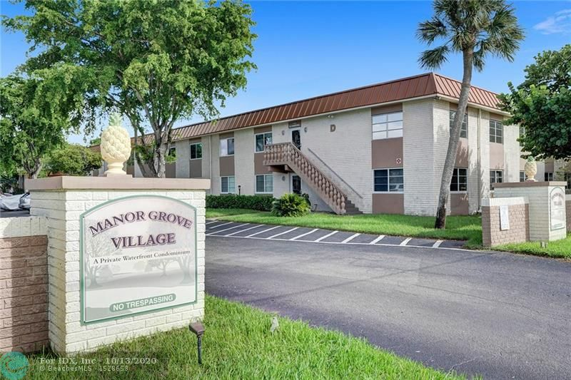 Designer inspired unit with great natural light and open feel.  Updated kitchen with Granite and stainless steel.  The kitchen has been opened up to the living and dining area, great flow! Manor Grove is walking distance to Wilton Drive's great entertaining district.  The complex has a great pool area and community center.  Tile floors throughout, updated bathroom, Massive Master bedroom with a huge walk-in closet.  Great for investors as the unit is allowed to be rented out immediately after purchase.  ask me about land lease reimbursement.