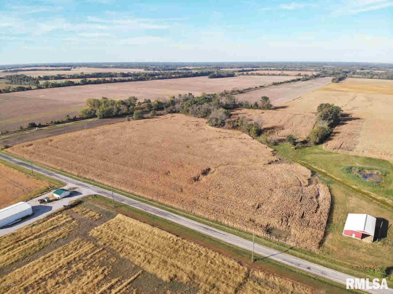 94 Acre home ( As Is) woodshed. This farm land is mostly tillable with older farm home and outbuildings. Portion suitable for cattle, portion row crop and the remainder is homesite. 72 Tillable, 19.24 home/pasture. The home is livable, however, there is no furnace or a/c. None