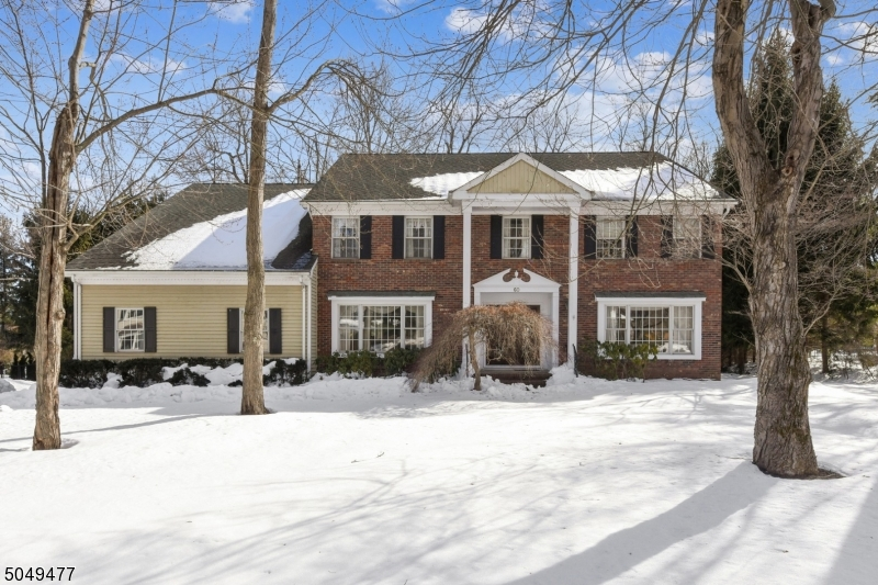 This ctr hall 11 rm 5 bed 4.1 bath colonial has an open floor plan with a traditional flair. Situated on .4 of an acre on a fabulous culdesac, this home is close to trains, schools and hiways, EWR. Madison is touted as #1 town in NJ. The home has generous sized rooms, abundant windows, lots of storage+ closets, high ceilings, 2 ensuite bedrooms (great for aupair,  guest room, or office), large deck overlooking level yard, sitting room off bedrm,  rec room + open space in basement. Wood floors thru most of home. Laundry/mud room on main flr. Just a few steps to garage.Terrific curb appeal with trees and shrubs. Just a super house and super area in Madison!