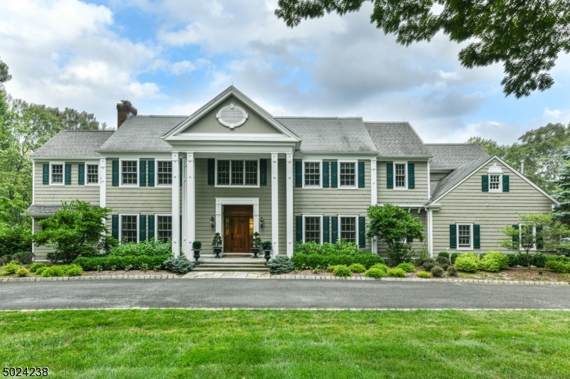 Stunning custom colonial style home located on one of the most desired streets on the Bernardsville Mountain.  This residence includes 5 spacious bedrooms and 6.1 baths set upon 5.57 private acres. Magnificent chef's kitchen provides top appliances and a huge island and a separate breakfast area with walls of windows which supply abundant natural light. This home provides a formal yet flexible design to meet today's dynamic life styles. The elegant master suite offers a sitting area, dressing room complete with two large w/i closets and a beautiful bathroom. This home provides a first floor office and a versatile bedroom suite off the back stairs. Finished w/o(s) basement includes kitchen, office, fitness room, wine cellar and media room that leads to blue stone patios and a private heated pool area.