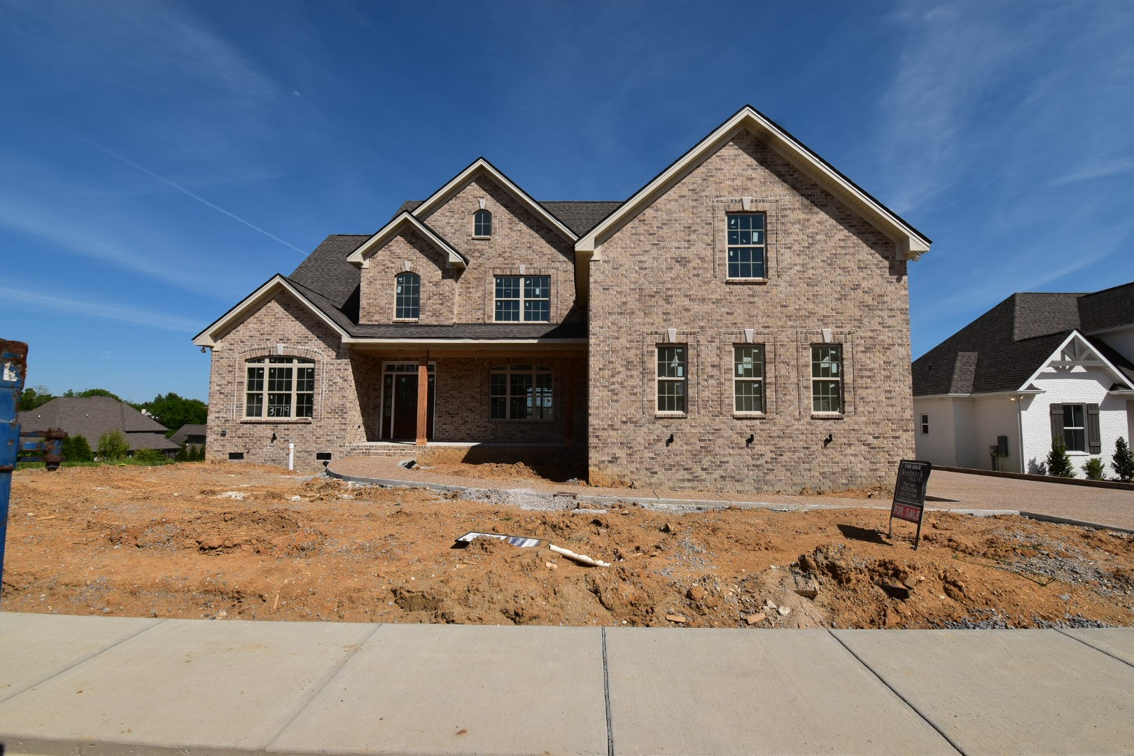 All Brick Home by RG Custom Homes. Gorgeous 2 Two Foyer with Curved staircase; Open two story great room w/ FP and catwalk above; Open Kitchen w/ White cabinetry, SS appliance pkg, Large Island, Granite counters; Master Suite down; Office on main; Large bonus room up; 3 Car Side Entry Garage.