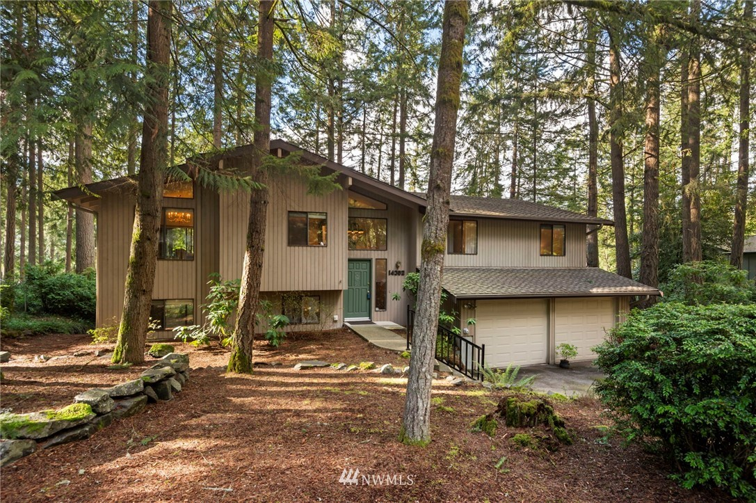 It's all about location and this home has IT! It's also about being in a great, established neighborhood where people still walk their dogs at night, wave hello to neighbors & enjoy neighborhood bbq's! This central location, close to St Anthony's, the YMCA, Gig Harbor North, Downtown & Uptown Gig Harbor will simply be the icing on the cake! Enjoy the vaulted ceilings in the living room w/gas fireplace, custom built-ins in the dining room, wood burning fireplace in the family room, and a third fireplace on the covered outdoor deck, making it a great place for entertaining! Don't forget to see the tennis courts, picnic area & walking trails! This home has been lovingly maintained for over 40 yrs! Now it's your turn to make this home your own!