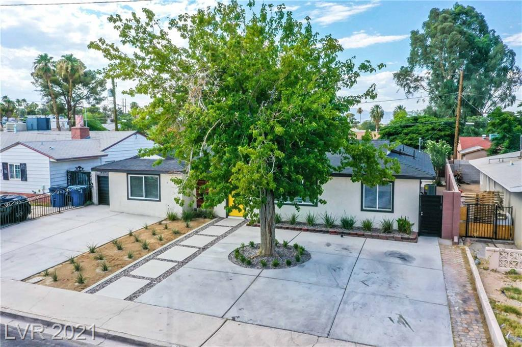 Lucky Seven bedroom home with two additional detached rooms out back. Come see this fully remodeled mid century modern home with upgraded water and sewer lines throughout. Offering a spacious custom kitchen, custom cabinets, quartz style counters with large island and breakfast bar counter. The kitchen also offers upgraded stainless appliances and a modern convertible style island range hood. There are a total of three wings; one with three bedrooms and bathroom; another with a jack and jill layout and the final wing offers a separate master bedroom suite. The master suite is larger and offers a roomy walk in closet with plenty of room for storage. The master bathroom includes a large custom shower; separate stand alone tub and a custom vanity with his/her sinks. There is a sliding door off the living room and large patio in the backyard. This home is perfect for a large extended family with parking for seven cars out front. Come take a look at this beautiful property!!
