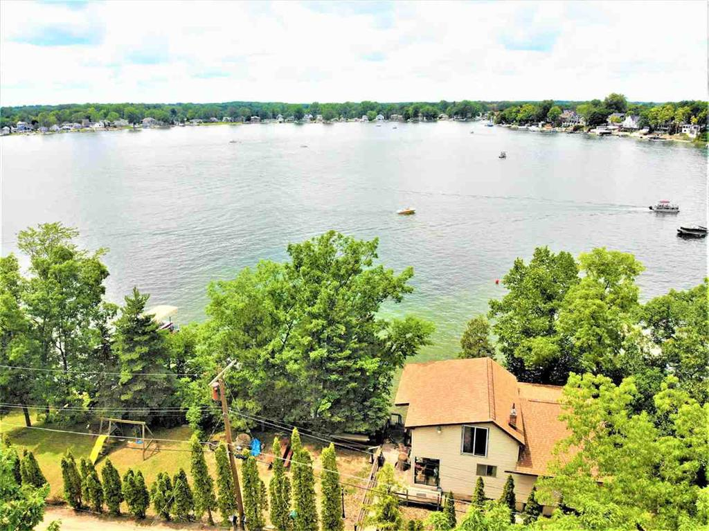Here it is, over 150 feet of waterfront property on All Sports Lake Fenton with spectacular views of the lake.  Lot is very spacious with a pole barn across the street for plenty of storage & all the parking you need.  Two-tiered deck for entertaining family & friends with mature trees. Two bedroom with large second bedroom upstairs that can be divided.  Updates within the last 5 years, roof, electrical, flooring, deck, siding, kitchen & downstairs bathroom.  This is prime property on Lake Fenton, schedule your showing ASAP!!
