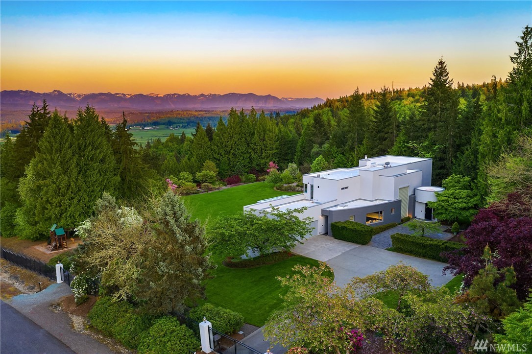 Modern Infusion from the pages of Architectural Digest. A Northwest masterpiece estate with elegant streamlined design, sleek surfaces and a deep connection to the outside landscape. 7400+sq ft renovated inside and out from exterior finishes and newly updated crisp white kitchen to new baths, luxurious flooring, and statement lighting. Walls of windows frame breathtaking Snoqualmie Valley and Mountain views. Coveted, gated privacy on 13+ lush acres, 11 car gar. parking. Minutes to Eastside Tech.