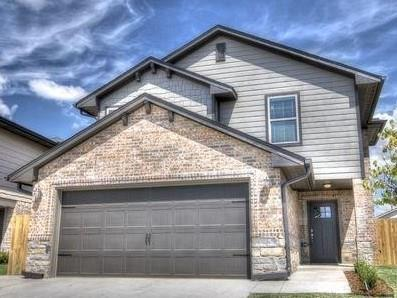 This home is absolutely gorgeous! Has that real modern feel, with stained concrete, beautiful kitchen with granite and all the stainless steel appliances. Them master is totally awesome with huge walk-in closet, separate his and hers vanities, walk in shower and whirlpool tub in the master. This is the one for you.  A look outside the front door and a few steps puts you in to the park. Newly built walking paths and crossing over Tom Strouhal Little River puts you at the kids play area and splash pad. I just wouldn't want to splash right now! There is a storm shelter in the two car garage. You just have to see this home to truly appreciate its location and its amenities!