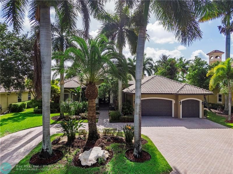 CUSTOM 1-STORY HOME IN THE PRIVATE DOUBLE GATED COMMUNITY OF THE FALLS IN HERON BAY. ENJOY THE BEAUTIFUL WATER AND GOLF COURSE VIEWS FROM THE MOMENT YOU ENTER. DESIRABLE TRIPLE SPLIT FLOOR-PLAN ON AN AMAZING GOLF COURSE LOT! IMMACULATE & UPGRADED THROUGHOUT WITH FRENCH DOORS, CROWN MOLDING, BUILT-IN OFFICE, CUSTOM CLOSETS, OUTDOOR CABANA BATHROOM, POOL, BEAUTIFUL LANDSCAPING, TRAVERTINE MARBLE PATIO WITH SCREEN ENCLOSURE & ACCORDION HURRICANE SHUTTERS. OPEN KITCHEN WITH CENTER ISLAND, GRANITE COUNTER-TOPS & DOUBLE OVEN. OVER-SIZED MASTER SUITE WITH SITTING AREA, FRENCH DOORS, BUILT-IN CLOSETS & SPACIOUS MASTER BATHROOM. PRIVATE BACKYARD WITH LUSH TROPICAL LANDSCAPING, POOL, SPA, TRAVERTINE PATIO & FENCED YARD. COMMUNITY CLUBHOUSE WITH POOL, TENNIS, FITNESS CENTER AND MORE!
