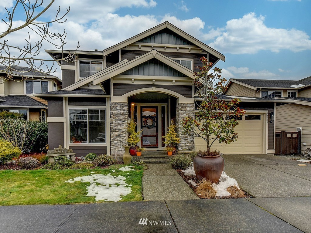 "Former model home full of upgrades and designer finishes! Pride of ownership-shows like new! ""The Sanctuary' features 2 large window walls that open onto an incredible covered outdoor living space(nearly 250 sq ft) complete with gas fireplace and BBQ area. Amazing walk through Butler's pantry. Chef's quartz kitchen. Amazing Master Suite with spa-like bath and walk-in closet with custom built-in cabinets. Main floor office/music room. Bonus Room upstairs is a perfect set up for an in home office. Air conditioning, WiFi Smart switches, finished 3 car garage with painted floor & walls and tons of overhead storage. Desirable location, backs to green space with pond and trail. Close to neighborhood park complete with sport court. Must see!"