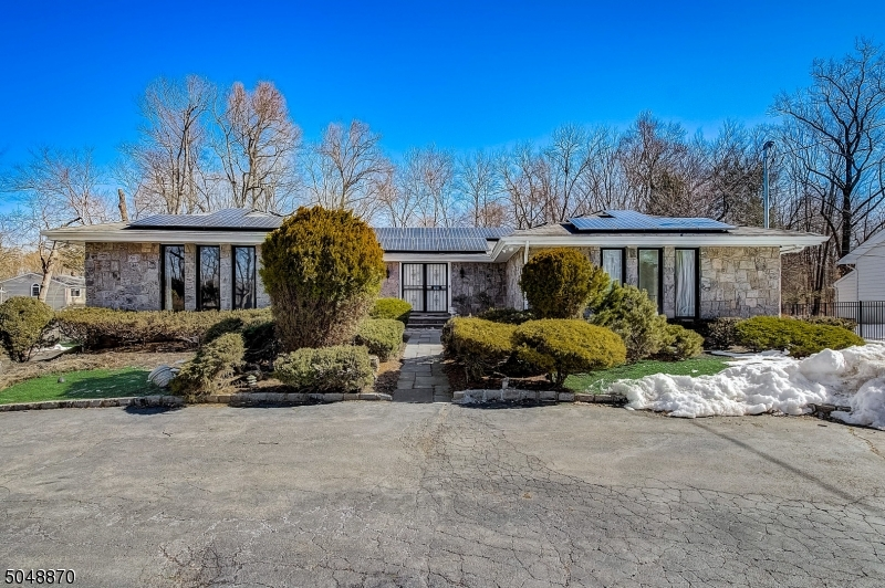 A Must See!!-- This is not your typical Ranch. Custom, energy efficient solar powered home in desirable Berkeley Heights!! Easy access to major roadways, shopping, restaurants & quality schools. From the spacious open entry, to the sunlight filled open floor plan, complete with Sunken Living Room, this home will 'Wow'. Large centrally located Great Room. Large primary bedroom with spacious storage options. New Appliances. Newer, contemporary baths found thru-out. Lower level en-suite offers adjoined or alternative entry point providing flexible living options. Extra finished areas with new bath located on lower level behind en-suite. Circular driveway with additional parking. Completely fenced for privacy. Beautiful hardwoods located under carpets. Loads of extras. This one won't last.