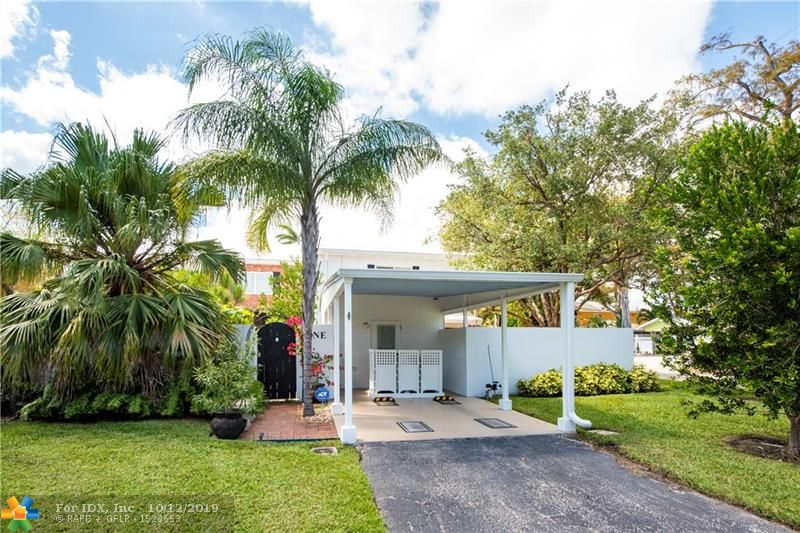 UNIQUELY DESIGNED ONE BEDROOM, BATH AND A HALF TOWNHOME IN WILTON MANORS.  COMPLETELY RENOVATED WITH OPEN KITCHEN AND STONE COUNTERS. TILE FLOORING ON 1ST LEVEL. HALF BATH ON THIS LEVEL. MASTER BEDROOM ON 2ND FLOOR INCLUDES  FULL BATH, LARGE WALK IN CLOSET AND  POLISHED CEMENT FLOORS. PRIVATE FENCED IN GARDEN AREA WITH  SCREENED  PATIO THAT OPENS TO THE LIVING ROOM. IMPACT DOORS AND WINDOWS THOUGHOUT THE UNIT. CARPORT INCLUDES ADDITIONAL OFFICE/ STORAGE SPACE. TROPICAL PARADISE! STEPS TO COMMUNITY POOL AND CLUBHOUSE SET ON THE NEW RIVER. COMPLEX HAS NO THROUGH TRAFFIC.  PET FRIENDLY COMMUNITY.