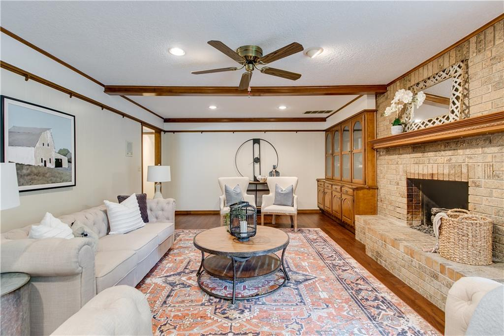 Here is your chance to make a sprawling & refreshingly updated home on a corner lot in Westwood Estates your very own! Located in a highly-desirable west Norman neighborhood, this house immediately impresses when you arrive and see the spacious lawn and circle driveway. You'll enjoy the modern updates all while still having hints of yester-year's charm! Engineered hardwoods were just installed! The front living room offers lots of sunlight and is ideal for a home office. The kitchen features double-ovens, new stainless appliances, backsplash, granite counters & loads of cabinet space! The guest bath features new, dazzling granite counters. Each bedroom is also generous in size & features brand new, plush carpet. Thermal windows were installed for maximum energy efficiency and give a refreshed appearance. Other updates include new paint throughout, refinished trim, hardware and select lighting. Cleveland Elementary, the Westwood Golf Course and revived water park are only steps away!