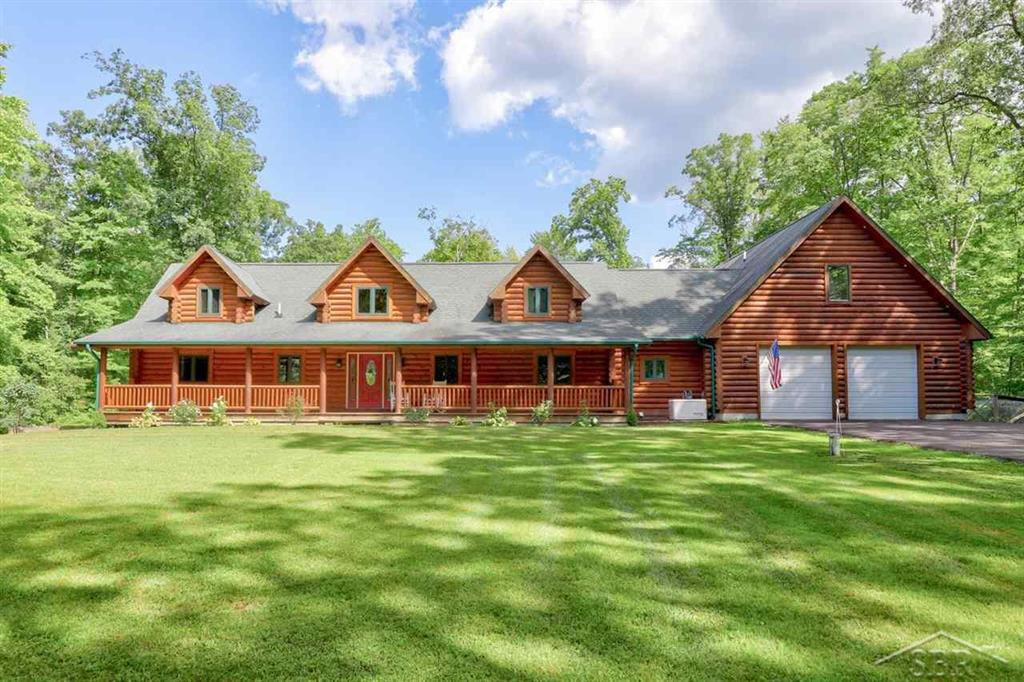 This pristinely detailed, timelessly embellished, 2955 square foot, 4 bedroom, 2.5 bath classic log cabin home is one for the books. It warms the soul upon first impression and captures the hearts of all who walk through its front door. Located among 10 lush acres of woods, it is a setting where any nature lover would thrive and appreciate beyond expression. Basque in the elements while enjoying all the comforts and special features this home has to offer such as the large open great room with majestic fireplace, a first-floor primary bedroom suite, first floor office, first floor laundry, a large walk-in pantry, and perfect mud room off the extraordinary large garage. Other features include a generator, swimming pool, new deck, driveway and outdoor shed. A home for the wholehearted?.are you ready to say yes to your next home?
