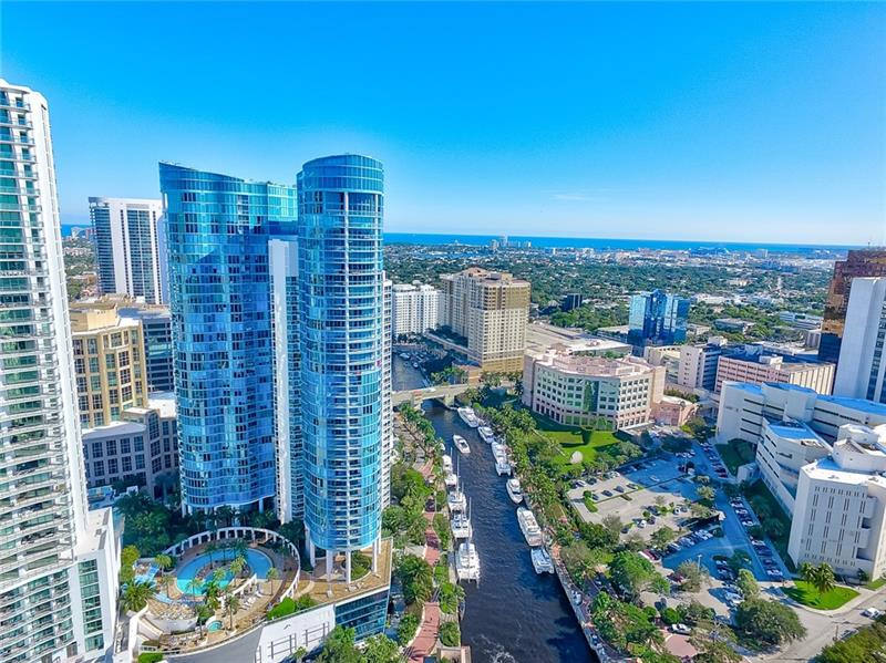 Boasting gorgeous views from every room and a thoughtful open plan layout, this condo is a paradigm of Las Olas Fort Lauderdale living. Beyond a grand entryway space, the home flows into a bright, open concept living, dining, and kitchen area. Features of this condo include high ceilings, an expansive master bedroom, floor to ceiling windows with South East and South West exposure perfect for morning coffee watching the sunrise over the Atlantic Ocean, and watching the sunset while enjoying a glass of wine picked up from your very own wine cooler. The Las Olas River House towers over the Downtown Las Olas area and is an iconic building in Fort Lauderdale. Featuring world-class amenities, a private foyer, and conveniently located within minutes from all Fort Lauderdale has to offer.