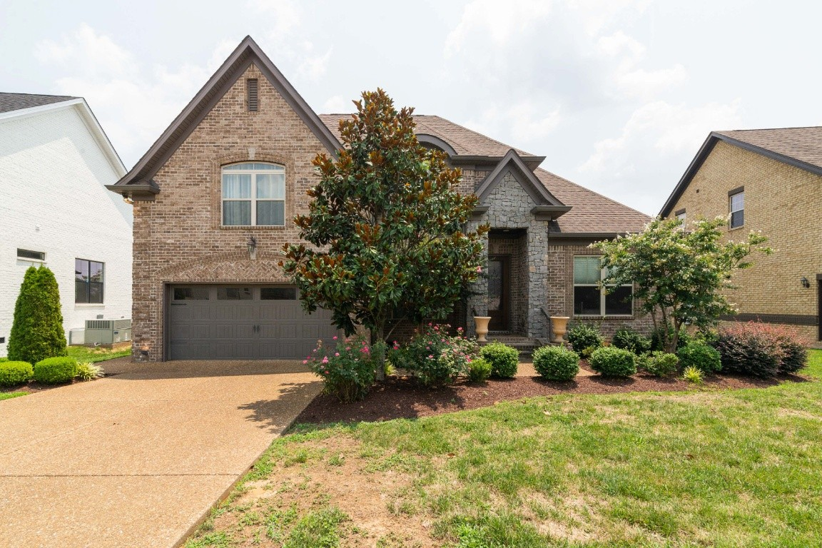 Oh so many features in this home that you will love! hardwoods throughout the main level and coffered ceilings in the foyer area. The main level also features the primary bedroom suite with large shower and separate tub. Bedroom #2 is located on the main level as well. Check out the large kitchen with gas range and plenty of room for the chef of the family. The large bonus room is pre-wired for surround sound. Relax on the screened in porch looking into the large fenced in and level yard.