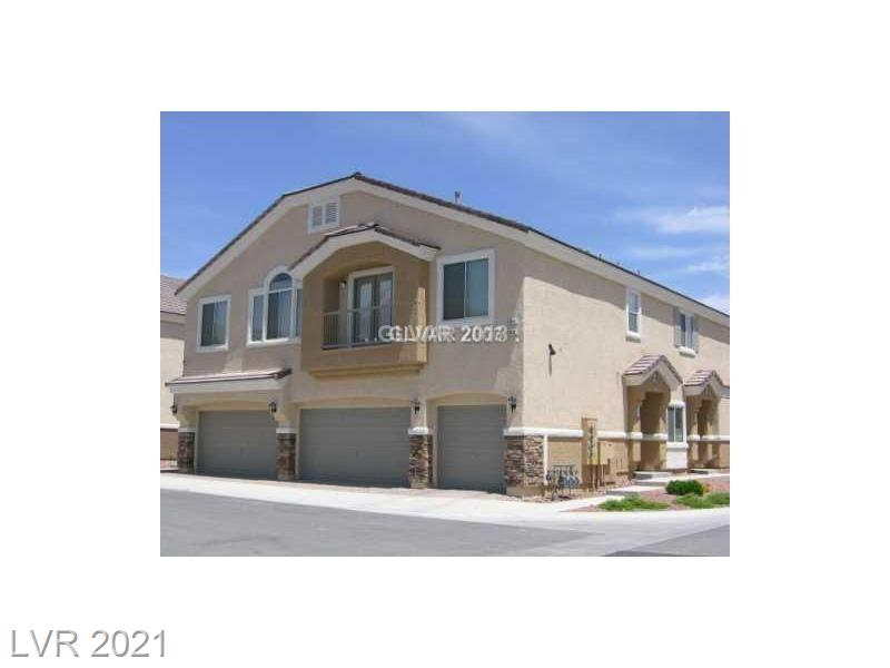 Superb Aliante Master Plan 2 Story Townhome with attached garage....fully applianced, Corian and Cultured Marble tops...Vaults in Living Room , Dining area, Balcony off Living Room...Large Master with walk in closet and separate bath with dual vanities, quality 6 panel doors throughout...lush, well maintained grounds with swimming pool not far from property....close to everything