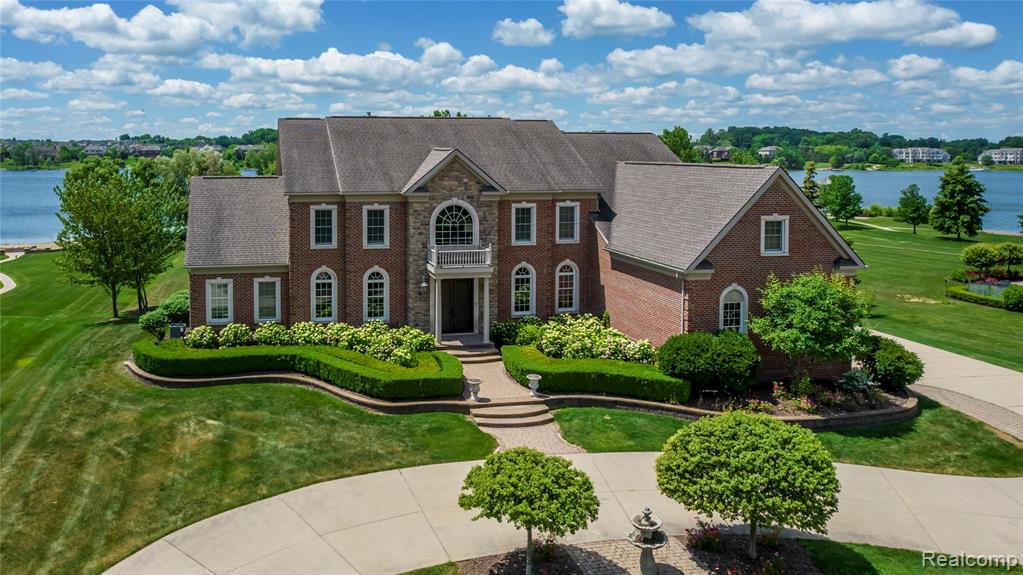 Welcome home to your waterfront estate located on the beautiful Island Lake in Novi. Enter into a grand 2 story foyer with a double staircase and stunning hardwood floors. The 2 story great room with coffered ceiling and soaring windows will lead you into the butler's pantry and gourmet kitchen with a large center island, custom built ins, and walk out access to the back deck. Formal dining room, bedroom with full ensuite and sunroom, and a mud room complete the main floor. Second floor master suite with sitting area, dual sided fireplace, and a relaxing master bath. Second floor laundry and three additional bedrooms with attached full bathrooms and walk-in closets. Finished walkout lower level with family room, media room, office or optional sixth bedroom with attached full bath. Walkout to your backyard patio and yard that will lead you to your private dock, beautiful landscaping and a large garden. Also available land contract sale of 1.8M with 20% down.