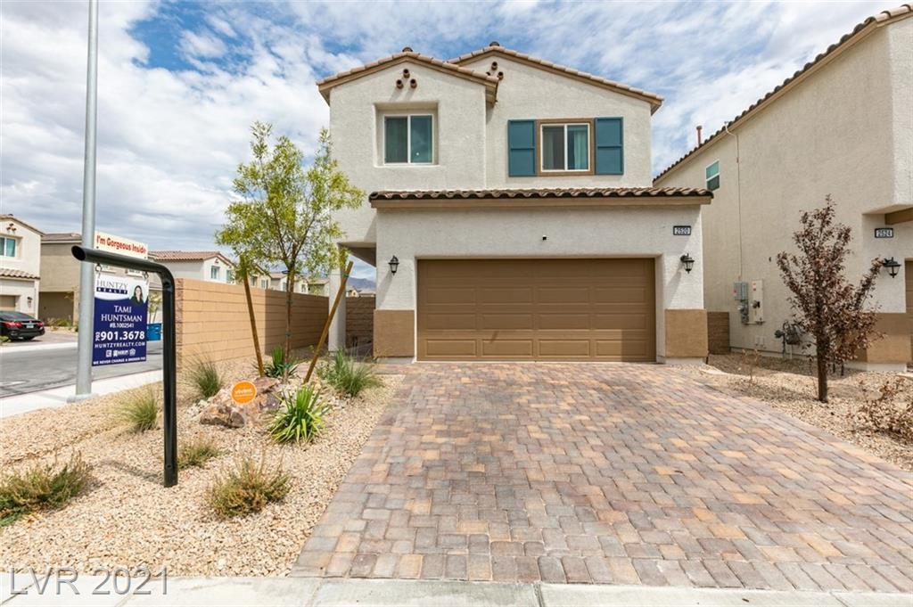 """Built 2021, Two-story home with extra big backyard, in a gated community. This home features 3 bedrooms, a den, 2 1/2 bathrooms, and the 24'x16' super-loft option upstairs. It also features granite countertops, matte black Kohler single basin under-mount sink, and white 36"""" cabinets with crown in the kitchen. Stainless steel appliances (refrigerator conveys with the home). Upgraded two-tone paint, upgraded aged bronze fixtures & accessories throughout home, ceiling fans in great room and super-loft, upgraded light fixtures in most areas, and luxury vinyl plank flooring throughout downstairs. Water softener, separate laundry room includes washer and dryer that conveys, upper cabinets, ship-lap and shelf. Come see this professional looking designed home!! The backyard is already beautifully complete with a huge paver patio, artificial turf, and garden area. Located near the VA hospital, a short drive to Nellis Air Force Base, and easy access to the 215-Beltway & I-15."""