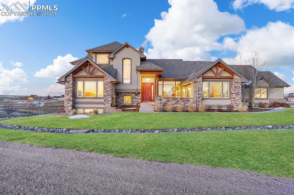 Come check out this twelve acre home located in the Cherry Creek Springs community, right off Black Forest Road! While close enough to hit city amenities and enroll in award winning schools, you can enjoy the comforts of a private custom-built home complete with a beamed vaulted ceiling and open floor plan.