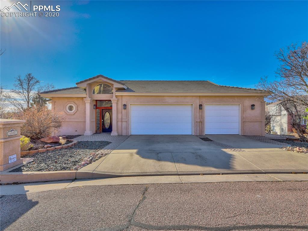 A truly rare find. 1350 Golden Hills Rd was built in 1996, but when you walk in, it will still take your breath away just as it did in the 90's. With an updated kitchen and master suite, real hardwood flooring, and spectacular views of Pikes Peak, this home is sure to create the sensation of luxury living. Have a lot of toys to store in the garage? With a garage space over 1500sqft, you will not only be able to fit 6 cars in the garage, but also space to store ATVs, have a work space, or extra storage (plus there is a secret, hidden garage that you will have to see for yourself!)