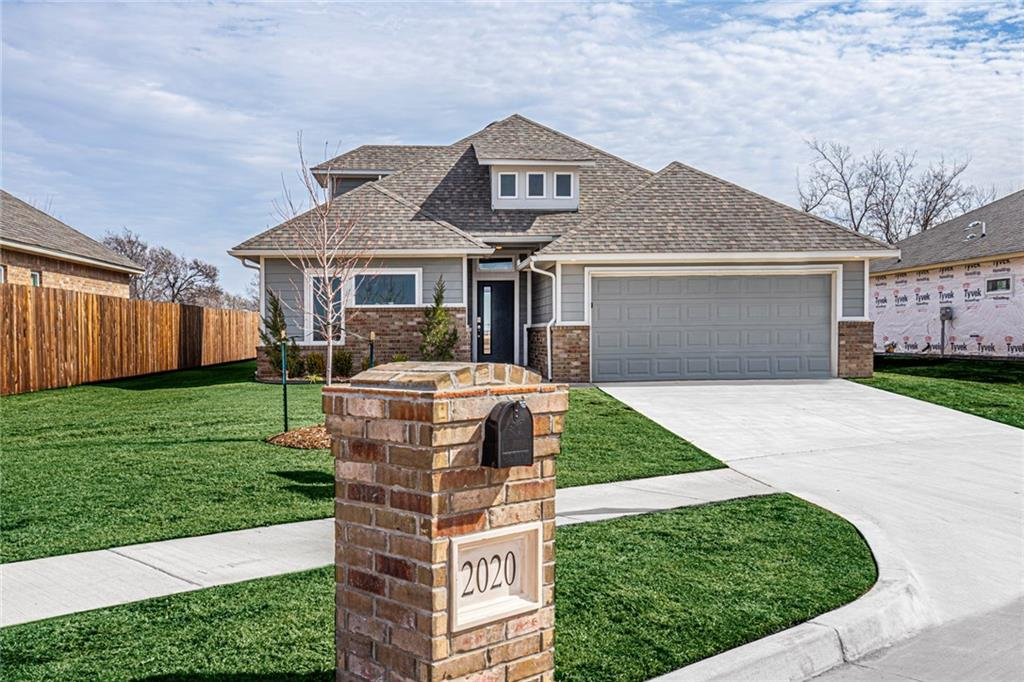 Ask about our monthly special!  This beautiful home is our newly revised Jordan plan. It features an upstairs bonus room in addition to a study nook right off the living room. You will love the neutral gray color palette, wood look flooring throughout the main living space, and 9 foot ceilings. The kitchen includes subway tile backsplash, quartz counters, and stainless-steel appliances. The master bath features a custom tiled shower, dual vanities, and private water closet. This High Performance home was built using NAHB Building Standards and includes the following: 2×6 exterior walls, custom shop built maple cabinetry, custom tile work,  fully footed post tension foundation, tankless hot water heater, high definition lifetime shingles, 95% high-efficiency furnace and 14 SEER A/C, AND it is HERS rated and Certified to OG&E's Positive Energy standards.