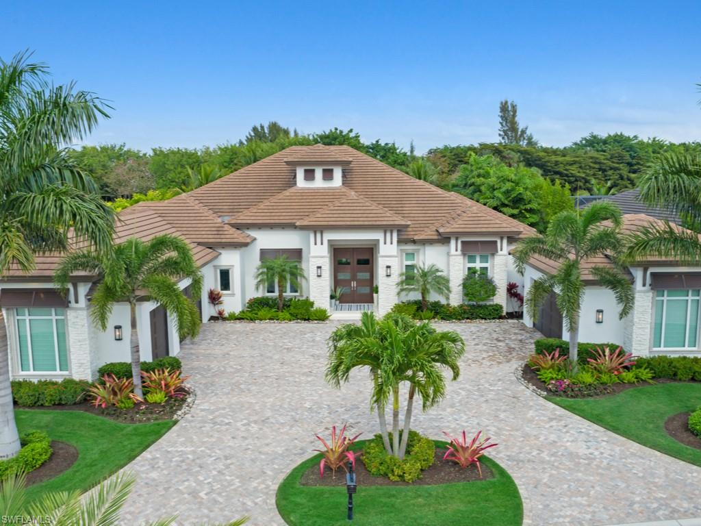 This immaculate 2017 custom-built estate home is professionally decorated by award-winning Design West Interiors and is being sold fully-furnished and accessorized for immediate enjoyment of Miromar Lakes' lifestyle. The waterfront home offers 4 en-suite bedrooms, office and billiards room in 4236 air-conditioned square feet. A pleasing palate of carefully curated whites, blues and organic tones calms the senses and complements the stunning architectural and designer detail throughout. The oversized lot affords tremendous privacy, circular motor-court, 3-car garage plus a car enthusiast's 2-bay garage. The custom salt-water pool and spa area overlook a private backyard boat dock with sundeck. New furnishings both inside and on the spacious lanai are included in this sale. Whole-house generator, hurricane impact windows, IPad controlled Sonos surround-sound, butler's pantry. Move-in ready for the buyer looking for the ultimate lifestyle in the #1 residential Community in the United States. 700 acres of freshwater lake, private white sand beaches, an award-winning beach club with restaurants, full-service spa and fitness center, tennis club, championship golf course and more await!