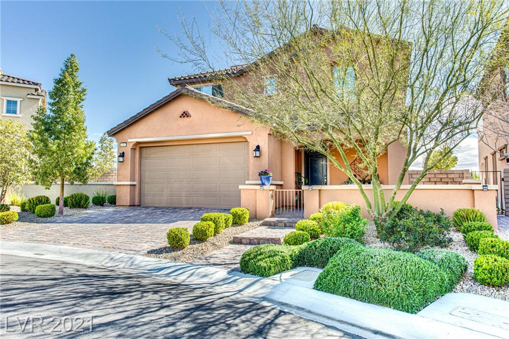VIEWS, VIEWS & MORE VIEWS in this 4BR+LOFT home in the Paseos w all the bells & whistles!  Enter into 2-story foyer leading to gorgeous Kitchen w lots of cabs, quartz cntrs w glass-tile backsplash, center island bkfst bar w pendant lighting, SS appls, eat-in dining area & AMAZING walk-in pantry. Adjacent Living Room features built-in fireplace against glass-tile accent wall w built-in shelves. DOWNSTAIRS MASTER BEDROOM has barn door leading to Master Bath w dual sinks, makeup table, designer tiled shower & CUSTOM walk-in closet. Upstairs is LOFT w 2nd fireplace surrounded by stacked stone & 2 built-in DVD storage units, 3 secondary BRs - one w ROOM-SIZE AMAZING CUSTOM WALK-IN CLOSET, full/half baths, balcony overlooking yard w Strip views. Rooftop Deck has 3rd fireplace & AMAZING PANORAMIC VIEWS IN EVERY DIRECTION! Entertainers backyard with sunken spa, wood decking, pavers and beautiful landscape! Upgraded lighting, two-one paint, engineered barn wood flooring & tinted windows T/O.
