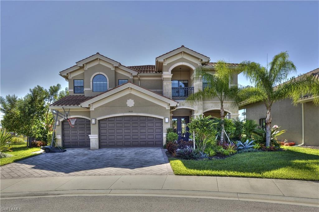 """Spectacular lake front home located on a Cul-de-sac with Southern exposure!  This Venetian floor plan with a long lake view has been meticulously maintained by the original owners. Featuring 5 bedrooms plus den with five full bathrooms.  The second floor master suite & bath is your own private retreat with a spa like bathroom including a jetted tub.  The large loft area plus a three car garage make this a perfect family home.  There are over $200,000 in upgrades including a custom built pool & spa by Nassau Pools, with a full two story screen cage.  There are all new Kitchen Aid appliance featuring a induction cook top, plus a large hidden walk-in  pantry make this kitchen perfect for your family. This open floor plan has view of the pool/spa and lake from all the main living areas, master bedroom, loft and one of the bedrooms.  The schools are all """"A"""" rated and the Riverstone resort style amenities with multiple pools, indoor sports complex, fitness center, tennis, pickle ball, gathering rooms and more, make this home & Riverstone the idea place to live in Naples. This is a must see today."""