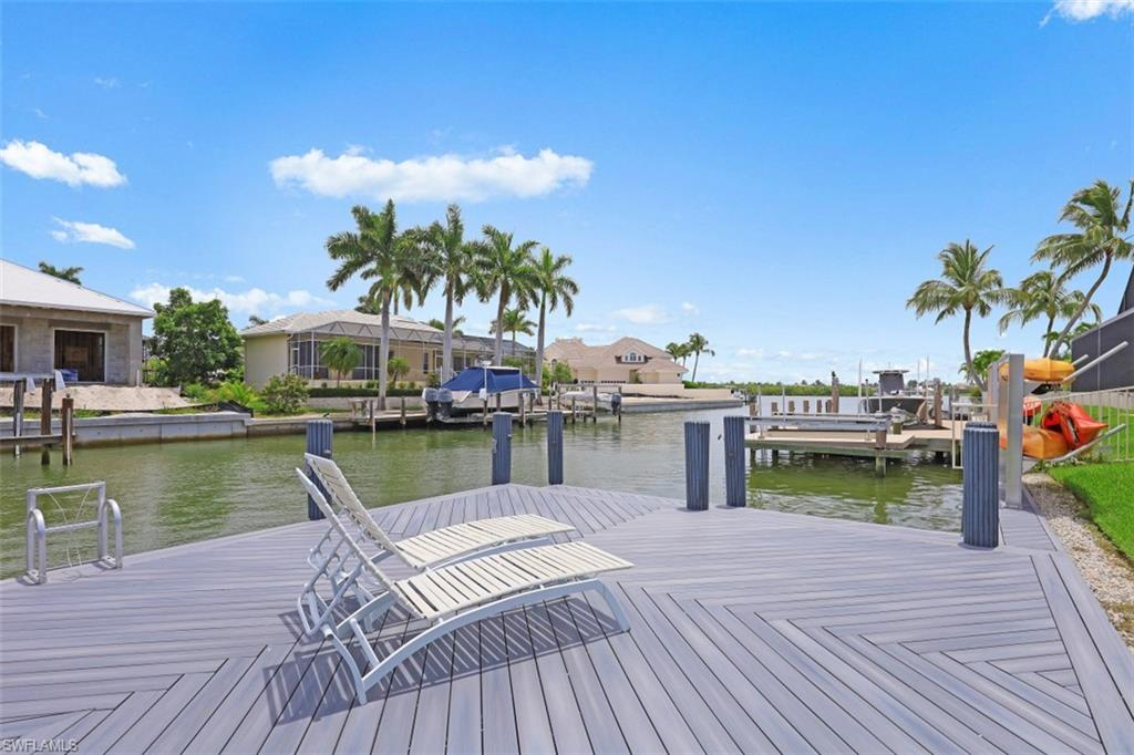 H2775 This Coastal Contemporary gem boasts stunning views out to Collier Bay, direct boating to the Gulf of Mexico, situated in desirable Tigertail Beach area, elegant finishes throughout, and almost 2,800 sq. ft. of luxury living! No expense spared in the renovation of the stunning, open floor plan home. Upon entry you are captivated with the flowing wood flooring (tile) throughout and custom ceiling with a combination of wainscot and dimensional designs. The gourmet kitchen boasts open views and features: quartz countertops, custom cabinets, walk-in pantry, Thermador appliances and gas stovetop.  All bathrooms have been renovated and include quartz countertops. The master suite boasts his and hers closets and a stunning bathroom featuring his and her sinks, walk-in shower, and custom cabinetry. Energy efficiency was priority to the homeowners including, gas tankless water heaters, gas stovetop, and gas dryer. Foam insulation, hurricane rated windows/doors, and LED lighting. With the extensive and quality renovation of this luxury home, as the new homeowner, you will have nothing to do but enjoy contemporary elegance along with beach enjoyment and boating in paradise.