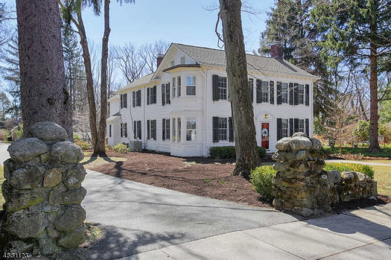 """Welcome to """"Rankin House"""", circa 1860's, a historically significant & wonderfully renovated 19th century Georgian style home, replete w original pumpkin pine flooring, & proudly sits on a pancake-flat half acre lot in the heart of storybook Mendham Boro.One-of-a-kind home w all of today's modern conveniences. 11 rooms, 5 bedrooms, 3 full baths,2 fireplaces,open floor plan family/great room, designer kitchen, library & 1st floor bedroom suite.This home offers 3,550 sq ft of commodious living space on 2 floors plus a full basement and 2 car detached garage. Second floor opens to wrap-around landing leading to 4 airy bedrooms & 2 full baths. Inviting master bedroom suite boasts a private, full sized sitting room and en suite full bath. Two expansive rear patios & fenced rear yard.Public water & sewer, gas & a/c."""