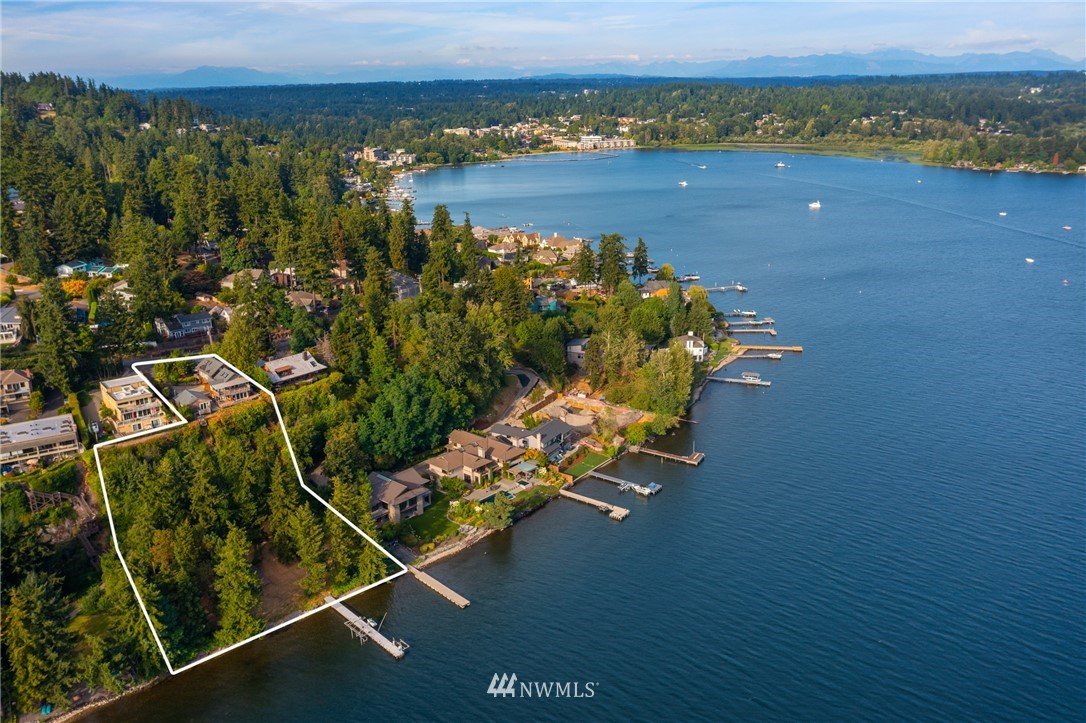 Total seclusion in the heart of Juanita.This property has a rare 220 feet of waterfront& endless possibilities;creating one's own private waterfront estate or a builder's dream waterfront lot to short plat for potentially 5 luxury residential homes or more!Many studies done & available per request.Enjoy southern exposure w stunning panoramic sunrise-to-sunset views of the Cascades, Kirkland, Bellevue, Seattle, Mt Rainier, & the Olympics.Manicured grounds slope to a private beach w 100 ft dock w 5 lifts ready for boats & jet skis.Minutes from downtown Kirkland, Bellevue & I-405, blocks to Juanita Village & beach.Located within the award-winning Lake Washington school district.This is a truly magical property & once in a lifetime opportunity!