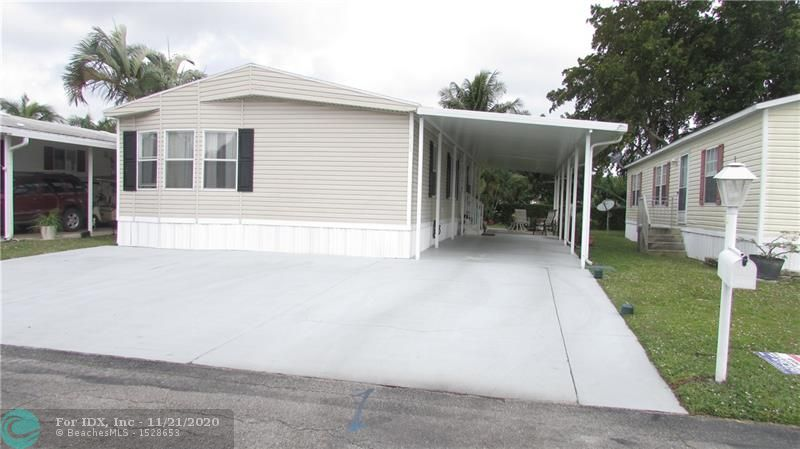 SPACIOUS 3 BEDROOM MOBILE HOME BUILT IN 2003, NEW SHINGLE ROOF IN 2018, NEW A/C IN 2015, VAULTED CEILINGS, CROWN MOLDING, AND SKYLIGHTS.  VINYL FLOORING THROUGH OUT, PLUS FREE STANDING OVERSIZED SHED.  PRIVATE BACKYARD AND PATIO AREA, AND DRIVEWAY WITH CARPORT PLUS 2 EXTRA IPEN PARKING SPACES.  LOW MAINTENANCE, CLUBHOUSE WITH A GYM, HEATED POOL, TENNIS, AND SOCIAL ACTIVITIES.  SMALL PET OK.