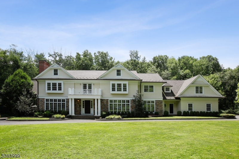 Exceptional Custom Colonial home with unparalleled workmanship and amenities, nestled on 7.5 acres on a private cul-de-sac in a desirable New Vernon neighborhood. Light streams into its opulent rooms through oversized windows, highlighting superb millwork, high ceilings, custom paneling, and gorgeous oak floors. Gourmet kitchen has thick marble countertops, two sinks, and top of the line appliances.  The two-story conservatory, magnificent paneled library, and five gas fireplaces create a unique retreat and fabulous home for entertaining. The finished, walk-out basement boasts a media room, exercise room and recreation room with a fireplace.  The enormous master suite contains large sitting room, walk-in closets, and spa-like bath.  Home is close to trains to NYC and has low taxes and excellent school system.