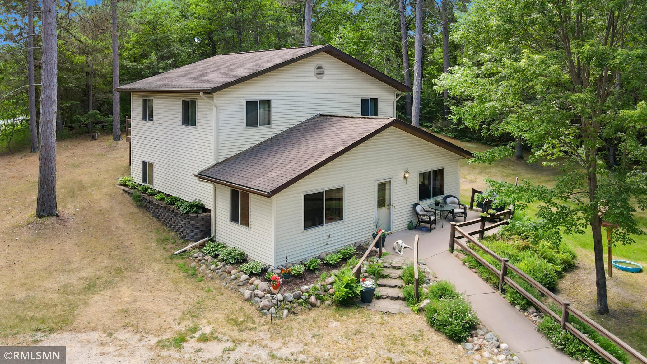 This home offers one level living with two bedrooms upstairs for guests or kids. Sitting on an acre you have complete privacy!  Close to town, yet gives the country feel.  Kitchen is spacious, main floor laundry and master bath all on the main level.  Handicap accessible with oversized doors and ramp to entry door.  The upstairs offers 2 bedrooms, bathroom and a family room, giving two comfortable private living spaces.  The garage is 24 X 48, the 4th stall has been finished off and can be used as a workshop, craft room or turned into a mother-in-law suite. Close to Pelican Lake, White Fish Chain, fine dining and several golf courses in the area.  Set up a private showing today!