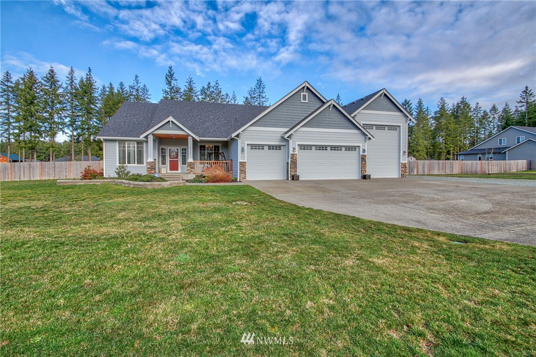 """Great NW Resale in Desirable Lacamas Valley, where every home has its own acre lot. This home boasts high end features and finishes that give it a custom feel. Beautiful white kitchen, with full length cabinets, oversized island, Costco Pantry and lots of """"Wow"""" factor. Formal and casual dining areas.  Huge master bedroom W/adjacent spa like bathroom which includes His & Her areas and a gorgeous Clawfoot Bathtub. The garage of your dreams!! Easily fit a 40 foot Motorhome and has drive through access to the backyard. The Covered patio and beautifully landscaped backyard is a picturesque setting! Just 20 minutes to local stores and 15 minutes to the East Gate of JBLM makes this the perfect location, you will love living here!"""