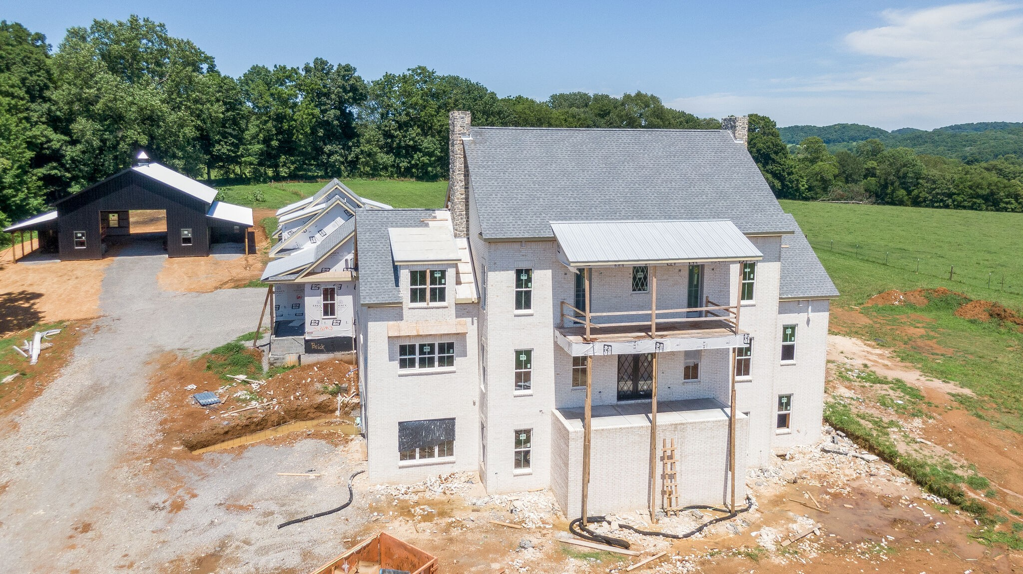 Incredible estate on 15 acres! Luxurious 10,000+ sq.ft. home full of amenities: 5 beds, 8.5 baths, 2 offices, movie theater, billiard room, bonus room w/wet bar, bunk room, basement kitchen & bar, unfinished gym, safe room, elevator, 4 car garage, balcony overlooking pool, black 64x60 barn, pond. Best views in Williamson Co! Kitchen will feature 2 islands and 2 dishwashers. Builder provides $120k pool allowance. Includes separate 5 acre tract w/5 bed perk site. Hurry & pick finishes w/designer!